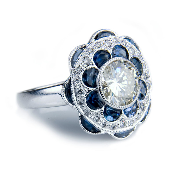 Edwardian style sapphire and diamond flower engagement ring<br /> <br /> Ceylon sapphire and old cut diamond Edwardian style engagement ring I snapped for Rumour's bespoke jewellery portfolio and website.