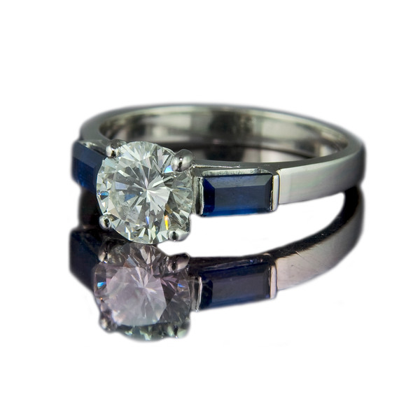 Diamond ring with sapphire baguettes