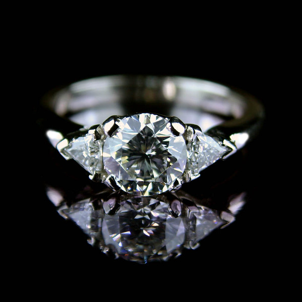 Brilliant cut diamond engagement ring with trillians<br /> <br /> One of my favourite engagement rings I photographed for Rumour's bespoke jewellery portfolio and website.