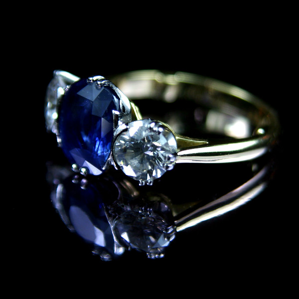 Cushion cut sapphire and brilliant engagement ring