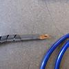 Crimped end with glued heatshrink tubing