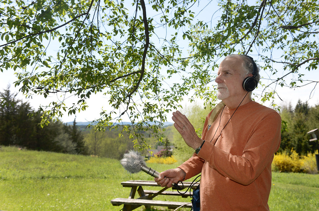 """. Tania Barricklo-Daily Freeman                      Jim Metzner uses a stereo microphone with a \""""dead cat\"""" wind screen to listen to birds in nearby trees."""
