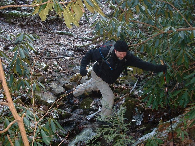 Demonstrating the finer points of stream- crossing/bushwacking.