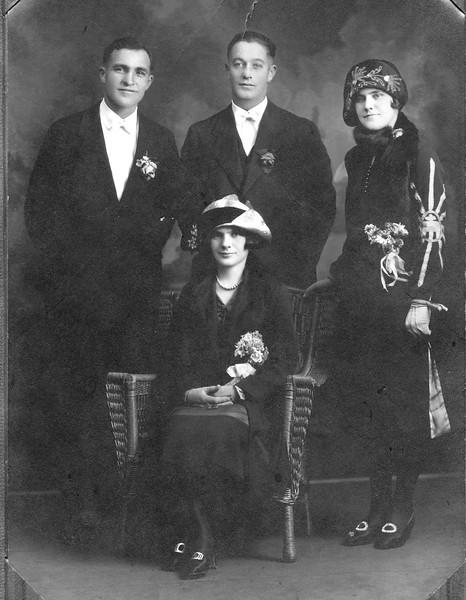 Joe Von Arx and Vernie Tschumper wedding.  Joe on left, then Johnny Von Arx, and Sophie (Tschumper) Truempi, and Vernie is sitting.