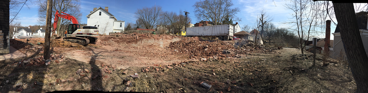 A Panoramic view of the demolition site of the John Brashear Factory as it appeared on Monday March 23, 2015 at 2:49 pm EDT one day prior before the the time capsule was opened.  Brashear's tan-sided residence appears at the far right side of the image behind the tree. Image - Al Paslow