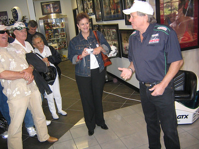 John Force keeps the crowd happy; Corrine Economacki looks on.