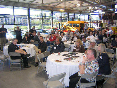 TUNED IN -- AARWBA members listen to John Force.