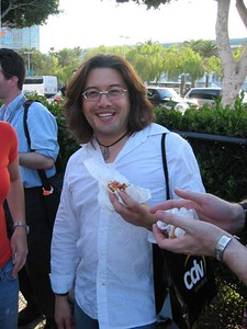 I'm eating a hotdog with Rob Atkins and Tom Hall on the way to another party at the Bonaventure Hotel.  We just stopped for a minute.