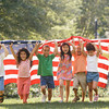 TA17.1 m556 / Choice 3 of 10 / Children running with American flag