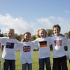TA17.1 m556 / Choice 4 of 10 / Children (6-7 years) in national flag T-shirts standing arm in arm