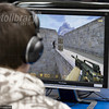 TA17.17 m580 / I couldn't tell if this one needed updating.   Choice 1 of 7 / Teenager playing First-person shooter, violent computer game