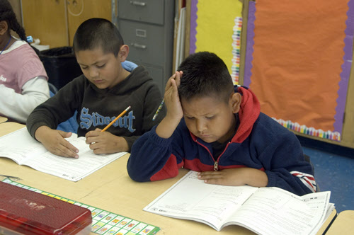 TA16.5 m521 / Choice 5 of 8 / Hispanic boys sitting in classroom take STAR (California Standard Testing and Reporting) test, Oakland, CA