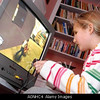 TA17.17 / m580 / Choice 7 of 7 / A0NHC4 Young girl playing violent 18 certificate rated computer game Grand Theft Auto on Sony Playstation console England Britain