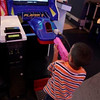 TA17.17 / m580 / Choice 6 of 7 / In this photo taken Sept. 2, 2009, a boy, using a toy weapon, plays a video game in Caracas. Venezuela's National Assembly is on track to prohibit violent video games and toys. The proposed legislation, which received initial approval in September, is expected to get a final vote in the coming weeks. (AP Photo/Ariana Cubillos)