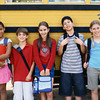 TA16.1 m517 / Choice 4 of 10 /Portrait of five children standing outside the school bus
