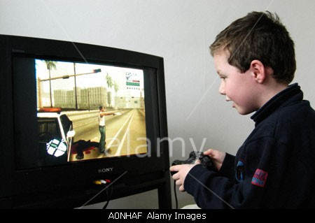 TA17.17 m580 / Choice 5 of 7 / A0NHAF Small boy playing violent 18 certificate rated computer game Grand Theft Auto on Sony Playstation console, England UK