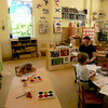 TA16.2 m518 / We used this image for this concept in Life Span.<br /> <br /> <br /> NYC., NY- WED. 05-30-07-30043636A REGGIO2 CTY-- A view of the classroom at The Madison Avenue Presbytrian Day School where The Reggio Emilia approach to teaching is used. Great attention is given to the look and feel of the classroom  The use of light is a strong component in the curriculum.   Students make paintings on translucent material  and hang them on the windows for light to shine through.                                                                            <br /> Photo Credit: Ruby Washington/The New York Times.<br /> <br /> Published 09-23-2007:  CITY SECTION - CY 8 PIONEERS AND OTHERS <br /> Reggio Emilia precepts at work at Madison Avenue Presbyterian Church Day School  (Ruby Washington/The New York Times)