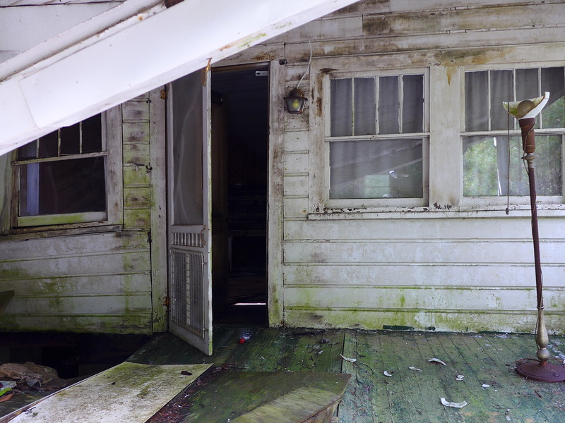 A closer view of the front door, underneath the collapsing porch roof