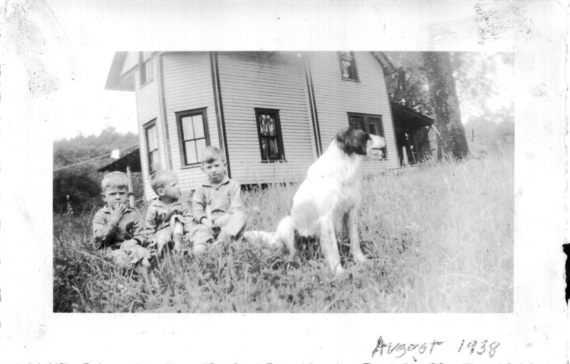Photo from John Snyder of the Loftis house, (also called the McGaha house, from his neighbors of the 1940s), for which the community of Loftis was named.   (l. To r.) John, Charles, and Teddy Snyder, and Spot.  Courtesy John Snyder.