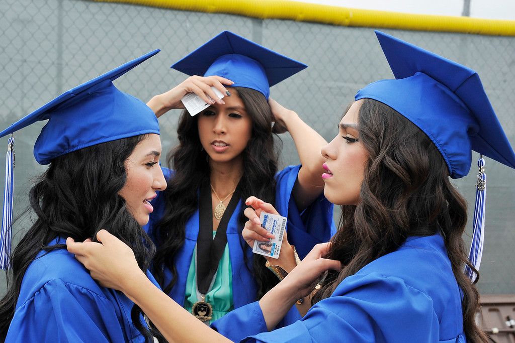 . LONG BEACH- 6/12/2013 - (Mark Savage) Ingrid Borrea, Stephanie Fernandez, and Jessica Quezada attend Jordan High School commencement at Veterans Memorial Stadium.