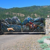 This large, sculptured gate opens to the Lostine River Ranch where quarter horses and rodeo horses are bred.