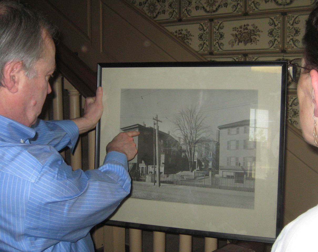 Bob showed us old photos of the house, which was set back behind other buildings.