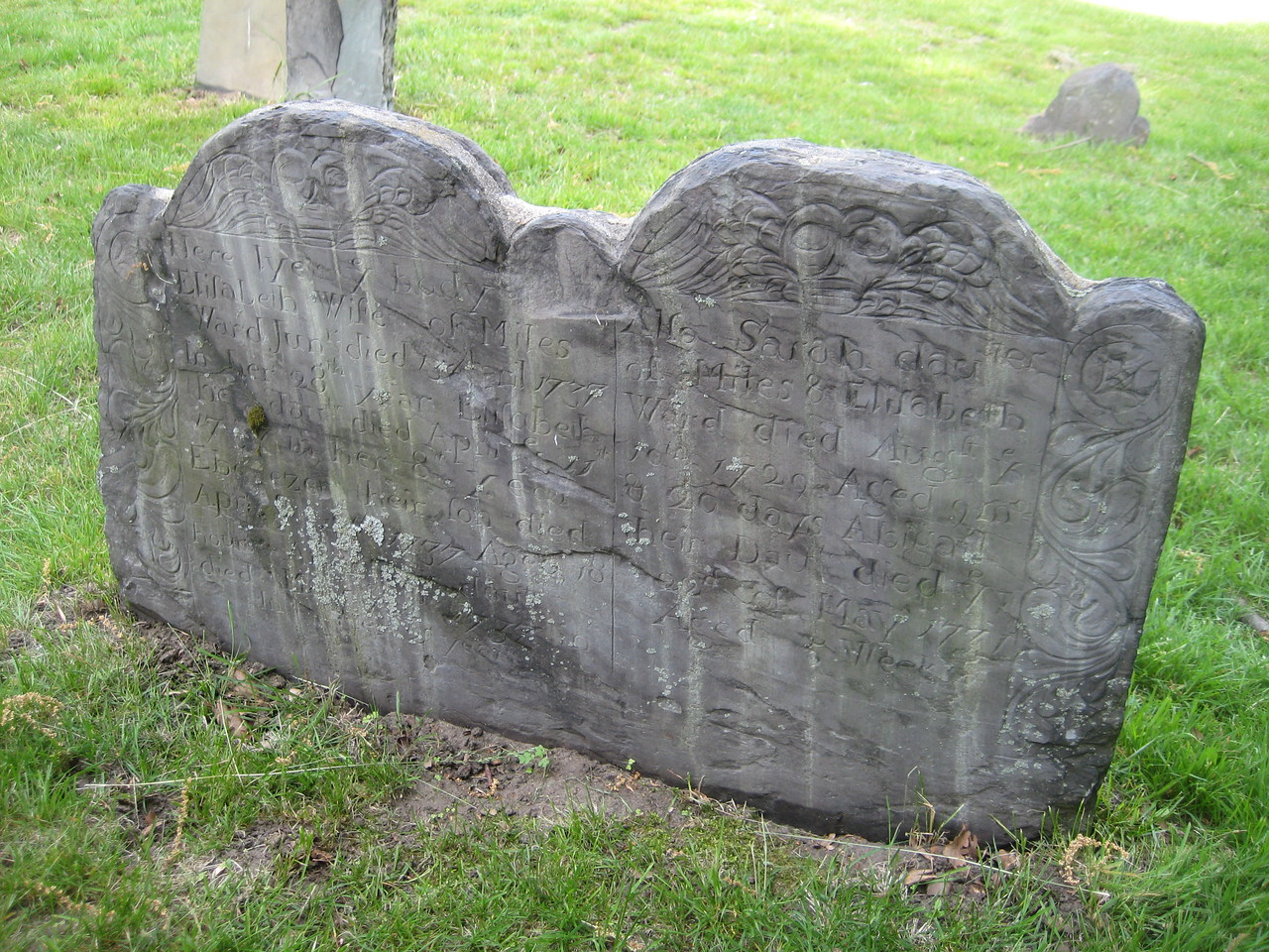"""Here lyes ye body of Elizabeth Wife of Miles Ward Jun[ior] died ... 1737 in her 28th year.""<br /> Also,  Elizabeth ... Ebenezer...    Also Sarah dau[ghter]...    Abigail."