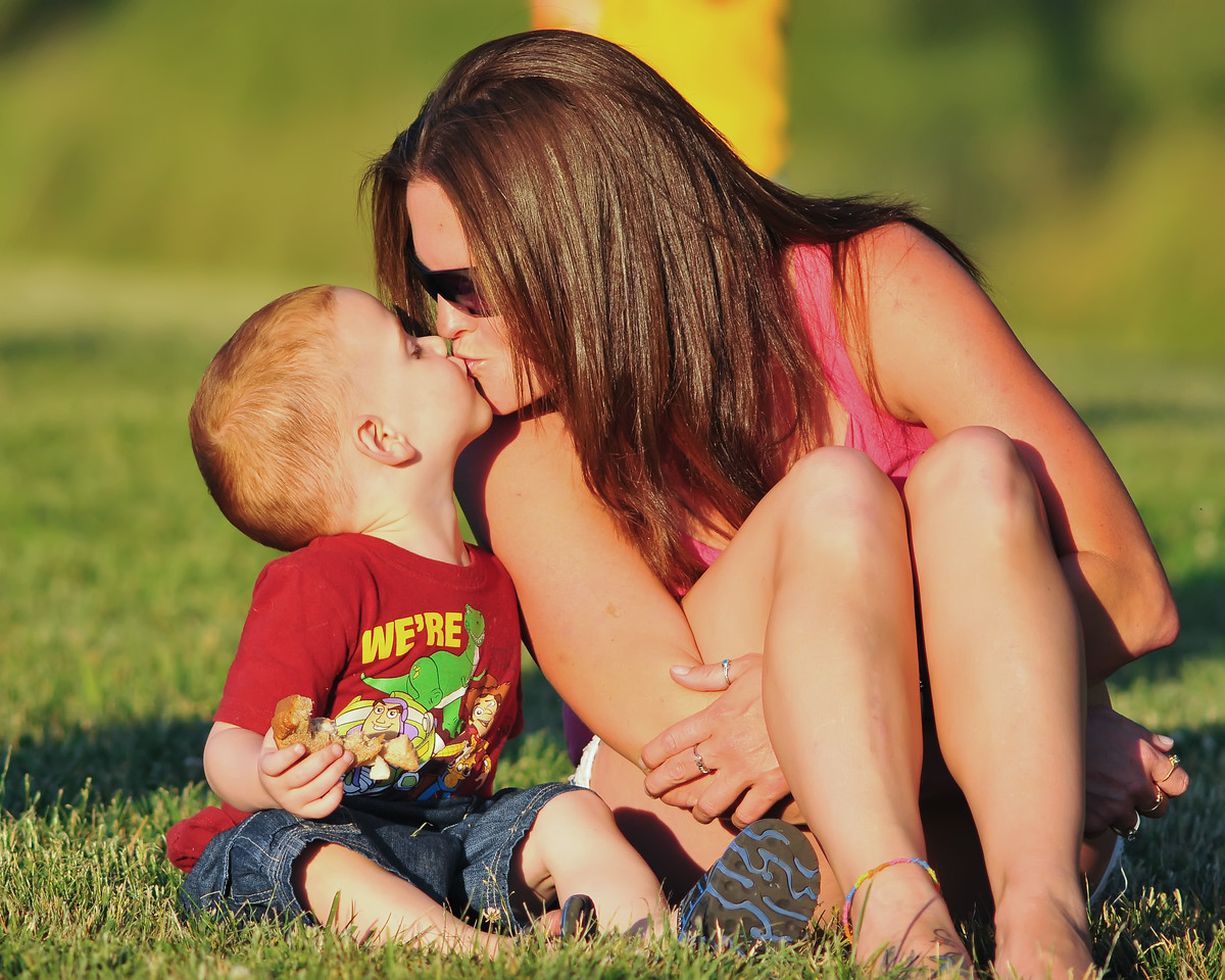 June 3rd,   I caught a few photos of a friend and her son.  It was pretty funny, she wanted a kiss and he kept pulling away.  This one he finally gave mom a kiss.