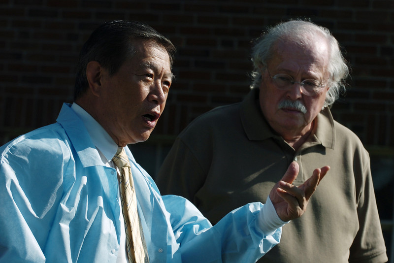 Forensic experts Dr. Henery Lee, left and Dr. Michael Baden answer questions about their autopsy of murder victim Joyce McLain at a press conference in Augusta on Friday, August 29, 2008.(Bangor Daily News/Kevin Bennett)