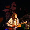 Julian Marley performs at Star Live in Beijing under an image of his father, Bob Marley.