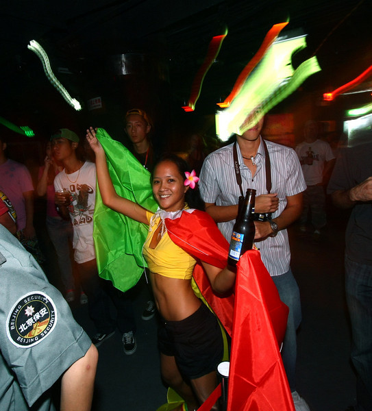 A young woman dressed in Rastafarian colors dances during the show.