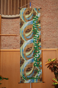 "Four banners, each containing pieces of the phrase ""We are called to be prophets of love and servants of reconciliation in a world which longs for justice and peace,"" were displayed during the gathering."