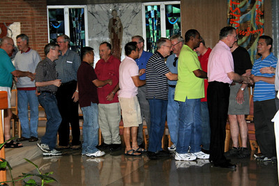 During morning prayer on Thursday, the group circled to greet each other during the sign of peace.