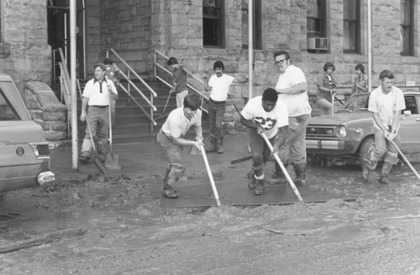 Cleanup workers cleaning up in front of city hall