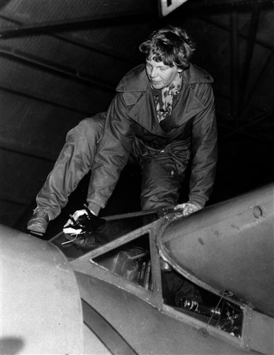. FILE - In this Jan. 14, 1935 file photo, Amelia Earhart climbs out of her plane at Oakland Airport in Oakland, Calif., after completing her 18 hour, 2,400 mile flight from Honolulu. (AP Photo/File)