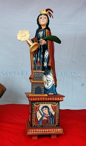 A painted bulto by Gilbert J. Montoya at Spanish Market on July 25, 2010, in downtown Santa Fe.                   Luis Sanchez Saturno/ The New Mexican.