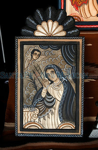 A retablo by Marie Sena at Spanish Market on July 25, 2010, in downtown Santa Fe.                   Luis Sanchez Saturno/ The New Mexican.