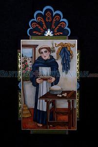 A retablo by Arlene Cisneros Sena at Spanish Market on July 25, 2010, in downtown Santa Fe.                   Luis Sanchez Saturno/ The New Mexican.