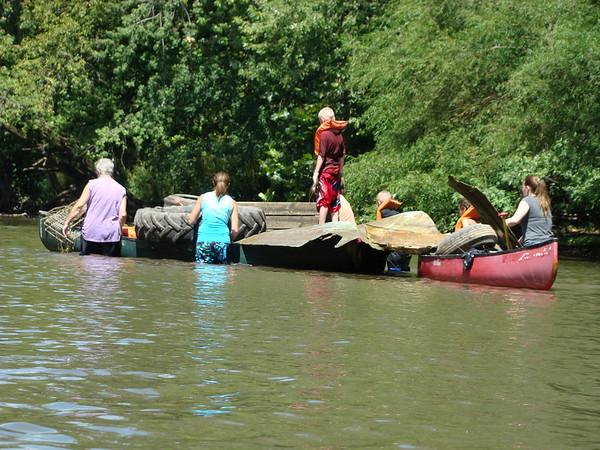 Volunteers pulling debris from the White River during the White River Watchers 2012 River Celebration.<br /> <br /> Photographer's Name: Judith DeLury<br /> Photographer's City and State: Markleville, IN