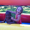 My daughter, Branlin McCoy, making up with her new friend on the giant slip-and-slide at Angela Johnson's home. <br /> <br /> Photographer's Name: Molly McCoy<br /> Photographer's City and State: Anderson, Ind.