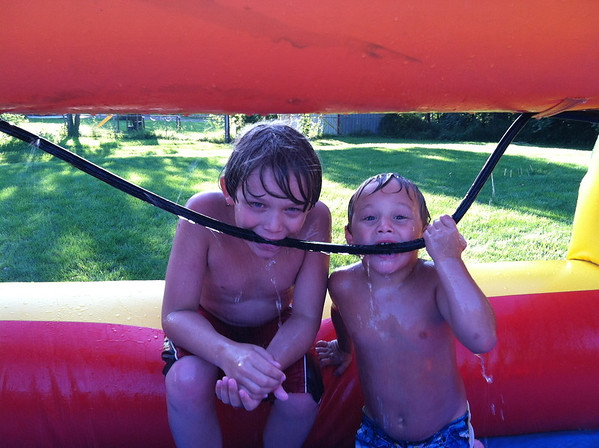 My sons Avery Jarvis & Thias McCoy getting a cold drink any way they can from the slip-and-slide at Angela Johnson's home.<br /> <br /> Photographer's Name: Molly McCoy<br /> Photographer's City and State: Anderson, Ind.
