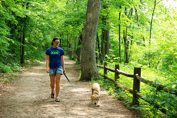 Grace Yoder walking her dog Maggie at Mounds State Park<br /> <br /> Photographer's Name: Morgan Elbert<br /> Photographer's City and State: Alexandria, IN