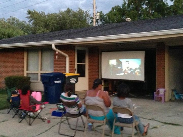 Damon Wallace hosts Sunday movie night in his neighborhood!<br /> <br /> Photographer's Name: Jacquieline Gwynn<br /> Photographer's City and State: Anderson, Ind.