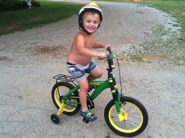 Thias McCoy, son of Molly and Brandon McCoy, takes his first ride of the summer on his new John Deere bicycle.<br /> <br /> Photographer's Name: Molly McCoy<br /> Photographer's City and State: Anderson, Ind.