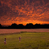 Sunset on July 4.  The grandsons Asher Ayers and Tristan Fox running in the grass waiting for it to get dark.<br /> <br /> Photographer's Name: Terry Lynn Ayers<br /> Photographer's City and State: anderson , IN