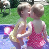 My 17-month-old twin grandbaby girls, McKenzie and Sophie Bell, kissing in their pool.<br /> <br /> Photographer's Name: Carole Bell<br /> Photographer's City and State: Anderson, Ind.