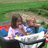 Our great-grandkids, Isabella and R.J. Morrin, getting a ride behind the tractor and eating fresh strawberries.<br /> <br /> Photographer's Name: Rex Rice<br /> Photographer's City and State: Middletown, Ind.