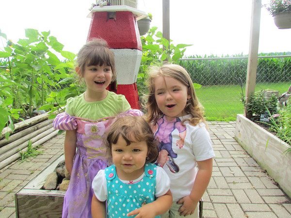 Nathalie Price, Addie Mac Voilles, and Aylssa McDaniel play around in the flower garden.<br /> <br /> Photographer's Name: Brian Fox<br /> Photographer's City and State: Anderson, Ind.