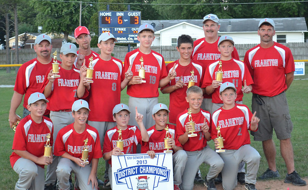 The Frankton 12-and-under boys are the Town and Country district champions. They survived with a 4-3 victory over Marion.<br /> <br /> Photographer's Name: Terry Ward<br /> Photographer's City and State: Frankton, Ind.