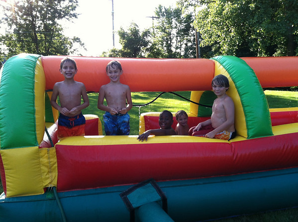 Braden Allen, my son Nolan Jarvis and friend Teshon Menifield, and sons Thias McCoy and Avery Jarvis enjoy the gigantic slip and slide that my friend Angela Johnson rented at her home. Great times for Braden Allen's birthday (his mother is Angela).<br /> <br /> Photographer's Name: Molly McCoy<br /> Photographer's City and State: Anderson, Ind.